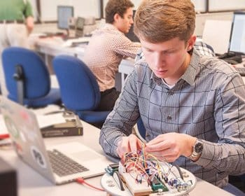 Pensacola Christian College Engineering Degrees student in engineeering lab
